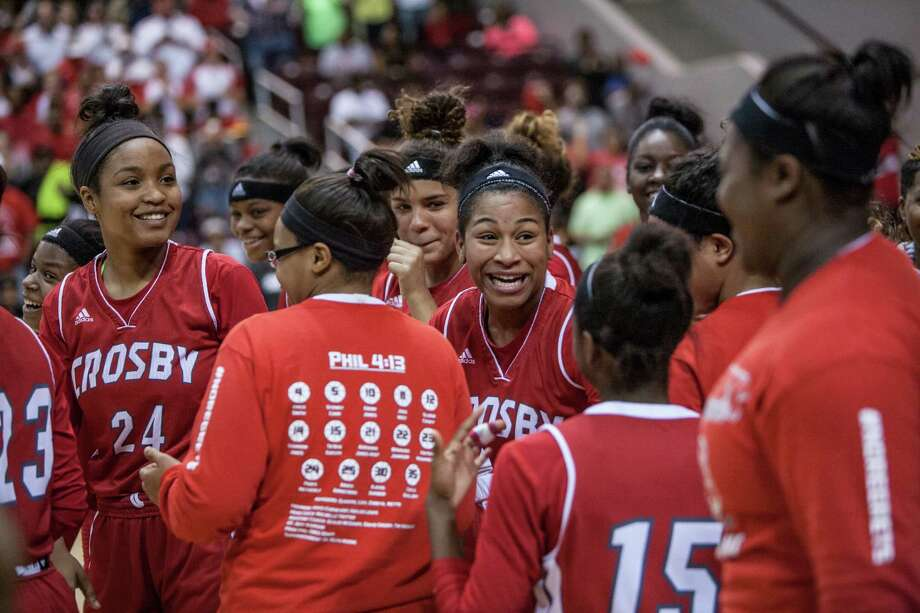 Amaya Armstrong of Crosby laughs with her teammates after defeating Bryan Rudder in a playoff game Saturday February 27, 2016. Bryan Rudder played Crosby in the girls basketball Region III finals at the Campbell Center. Photo: Michael Starghill, Jr. / © 2016 Michael Starghill, Jr.