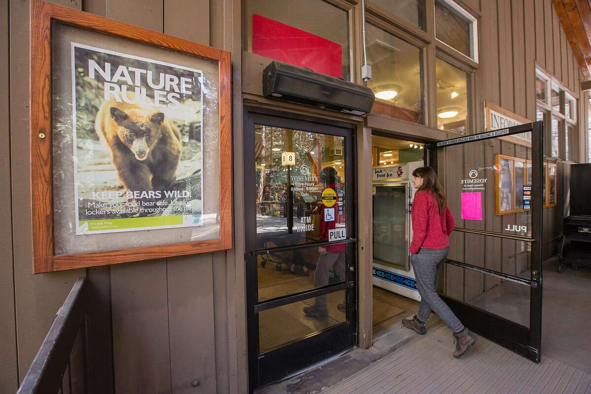 A customer walks into the Village Store at Yosemite National Park on Feb. 26.