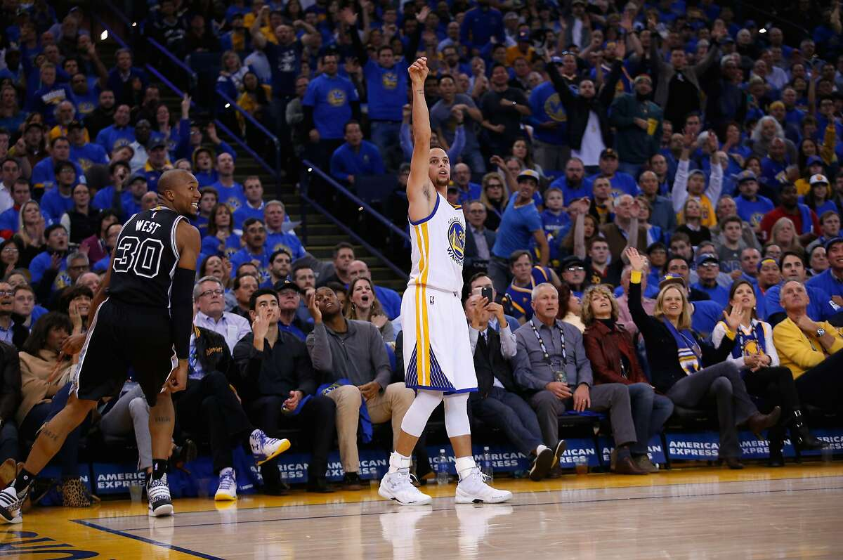 OAKLAND, CA - JANUARY 25: Stephen Curry #30 of the Golden State Warriors watches a three-point basket go in against the San Antonio Spurs at ORACLE Arena on January 25, 2016 in Oakland, California. NOTE TO USER: User expressly acknowledges and agrees that, by downloading and or using this photograph, User is consenting to the terms and conditions of the Getty Images License Agreement. (Photo by Ezra Shaw/Getty Images)