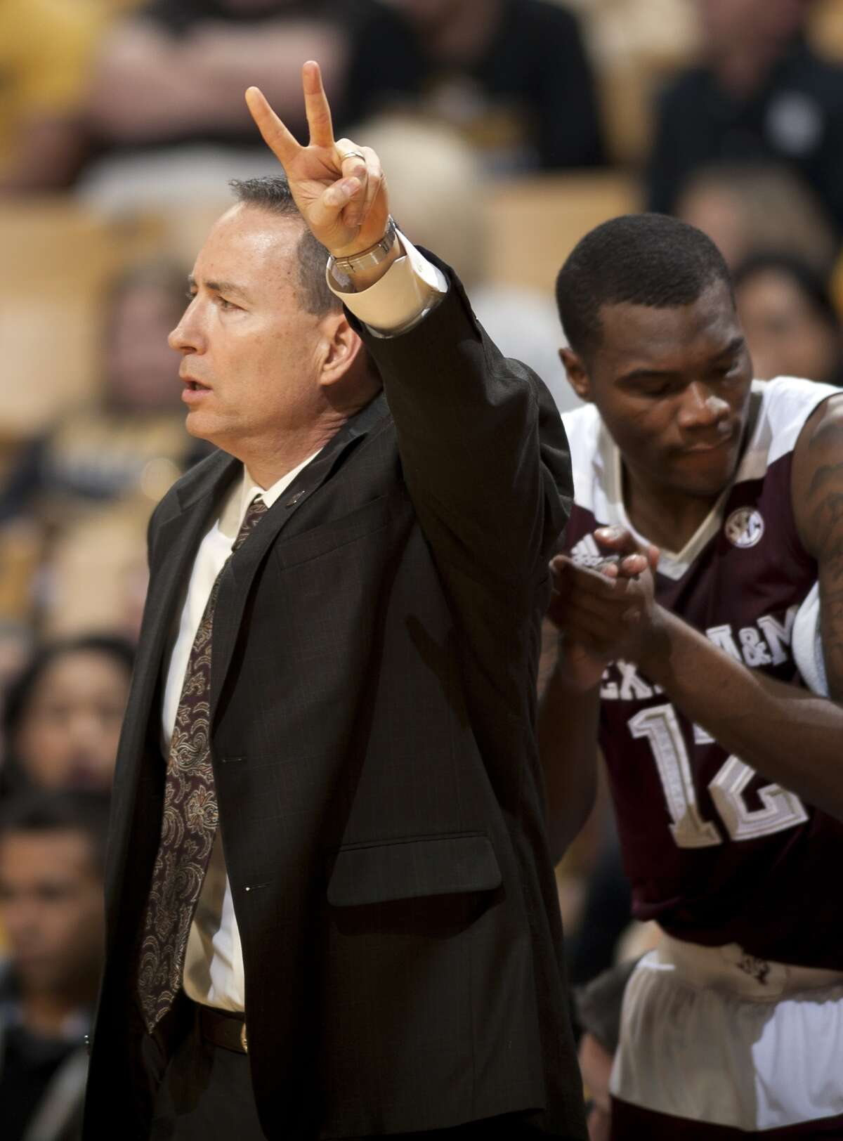 Texas A&M head coach Billy Kennedy, left, gestures from the bench alongside Jalen Jones during the first half of an NCAA college basketball game against Missouri, Saturday, Feb. 27, 2016, in Columbia, Mo. (Nick Schnelle/Columbia Daily Tribune via AP)