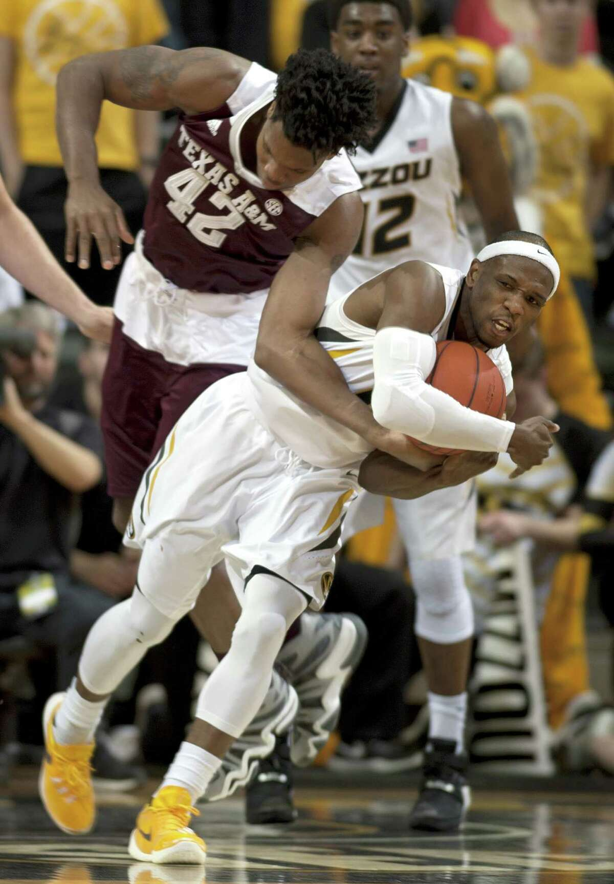 Missouri's Terrence Phillips, front, steals the ball from Texas A&M's Tavario Miller (42) during the first half of an NCAA college basketball game Saturday, Feb. 27, 2016, in Columbia, Mo. (Nick Schnelle/Columbia Daily Tribune via AP)