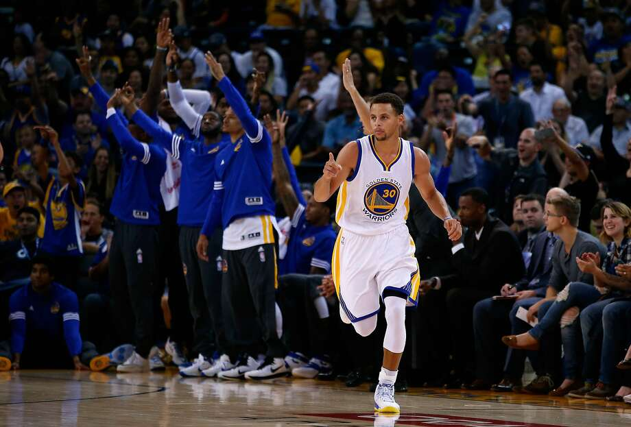 OAKLAND, CA - OCTOBER 13:  Stephen Curry #30 of the Golden State Warriors reacts after making a basket against the Denver Nuggets at ORACLE Arena on October 13, 2015 in Oakland, California. NOTE TO USER: User expressly acknowledges and agrees that, by downloading and or using this photograph, User is consenting to the terms and conditions of the Getty Images License Agreement.  (Photo by Ezra Shaw/Getty Images) Photo: Ezra Shaw, Getty Images