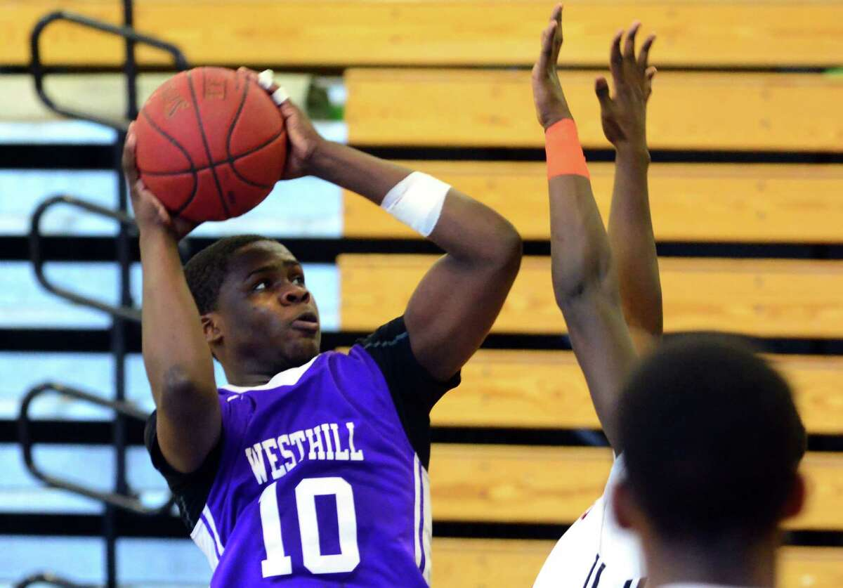 Westhill's Tyrell Alexander looks for two points during an FCIAC boys basketball quarterfinal against Stamford on Saturday.