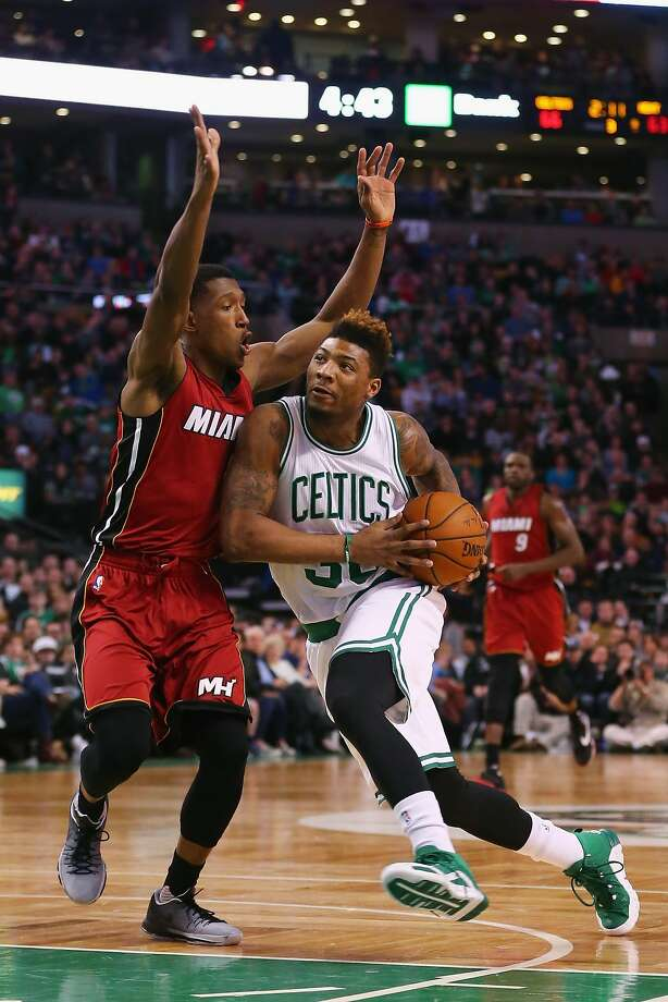 Boston's Marcus Smart drives against Josh Richardson of the Heat. Smart scored 15 points as the Celtics extended their home win streak to 10 games. Photo: Maddie Meyer, Getty Images