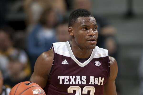 Texas A&M's Danuel House brings the ball down the court during the second half of an NCAA college basketball game against Missouri Saturday, Feb. 27, 2016, in Columbia, Mo. Texas A&M won 84-69. (Nick Schnelle/Columbia Daily Tribune via AP)