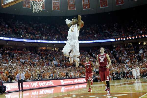 AUSTIN, TX - FEBRUARY 27: Kerwin Roach Jr. #12 of the Texas Longhorns dunks the ball against the Oklahoma Sooners at the Frank Erwin Center on February 27, 2016 in Austin, Texas.