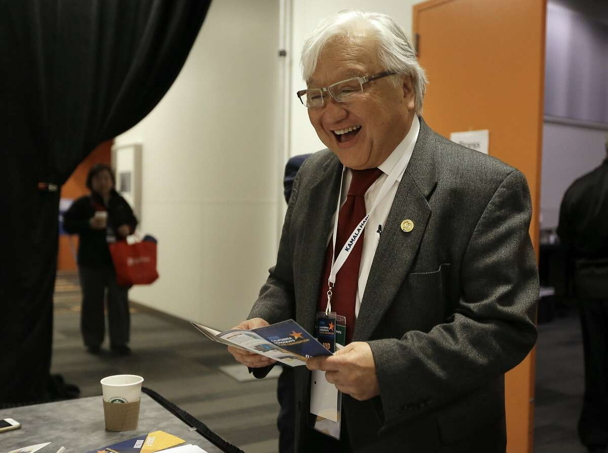 Rep. Mike Honda, D-Calif., smiles while speaking with a supporter during a break in the California Democrats State Convention Saturday, Feb. 27, 2016, in San Jose, Calif. (AP Photo/Ben Margot)