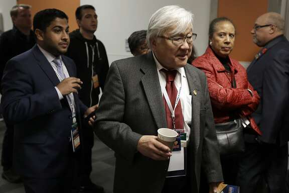 Rep. Mike Honda, D-Calif., center, exits the main hall during a break in the California Democrats State Convention Saturday, Feb. 27, 2016, in San Jose, Calif. (AP Photo/Ben Margot)