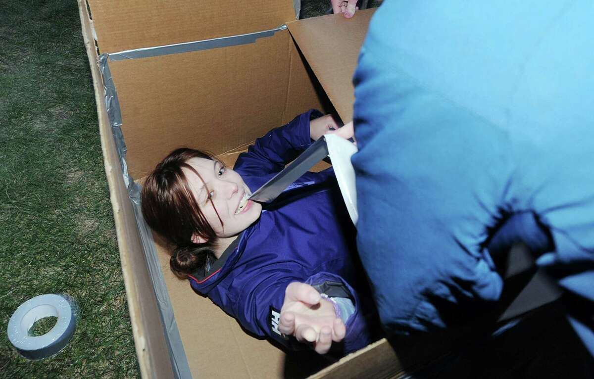 Greenwich High School senior Charlotte Lorthioir, 17, builds a cardboard shelter as part of the project by the Youth Groups of First Congregational Church, who were attempting to gain firsthand knowledge of the homeless experience, built a homeless encampment made out of cardboard boxes on the front lawn of the First Congregational Church, Old Greenwich, Conn., Saturday night, Feb. 27, 2016. Donald Haviland, a youth group minister at the church said the group would be spending the night in the shelters they contructed to raise awareness about homelessness and to seek donations of goods for Inspirica, a homeless shelter in Stamford.