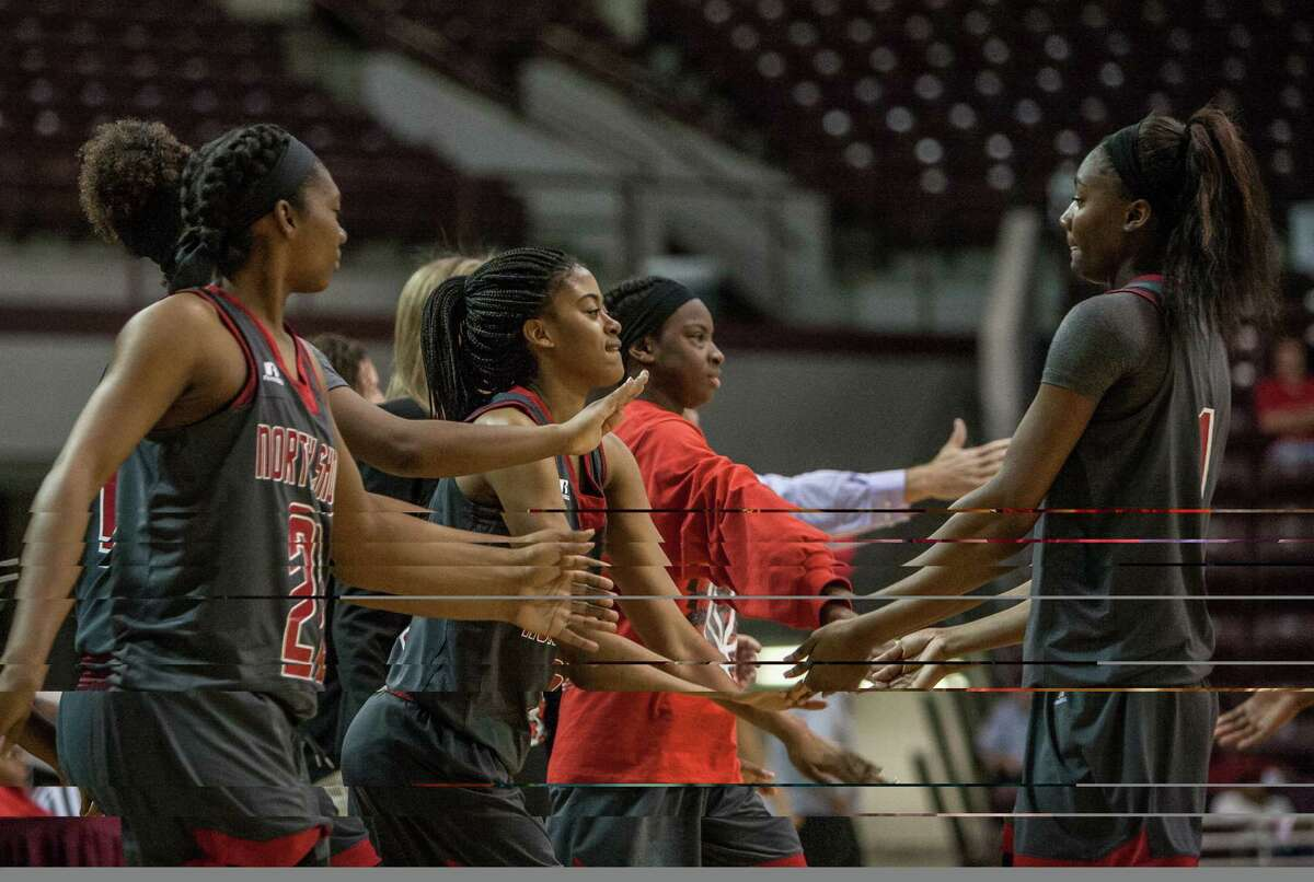 Mikayla Robinson of North Shore celebrates with her teammates as they approach the bench during a game Saturday February 27, 2016. North Shore played Clear Springs in the girls basketball Region III finals at the Campbell Center.