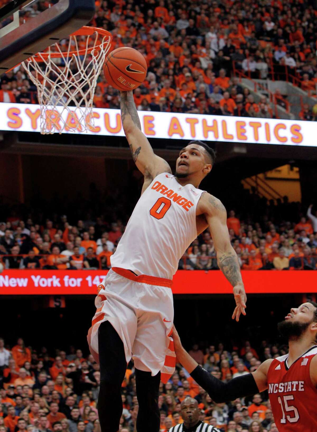 Syracuse?'s Michael Gbinije, left, dunks the ball over North Carolina State?'s Cody Martin, right, in the second half of an NCAA college basketball game in Syracuse, N.Y., Saturday, Feb. 27, 2016. Syracuse won 75-66. (AP Photo/Nick Lisi) ORG XMIT: NYNL106