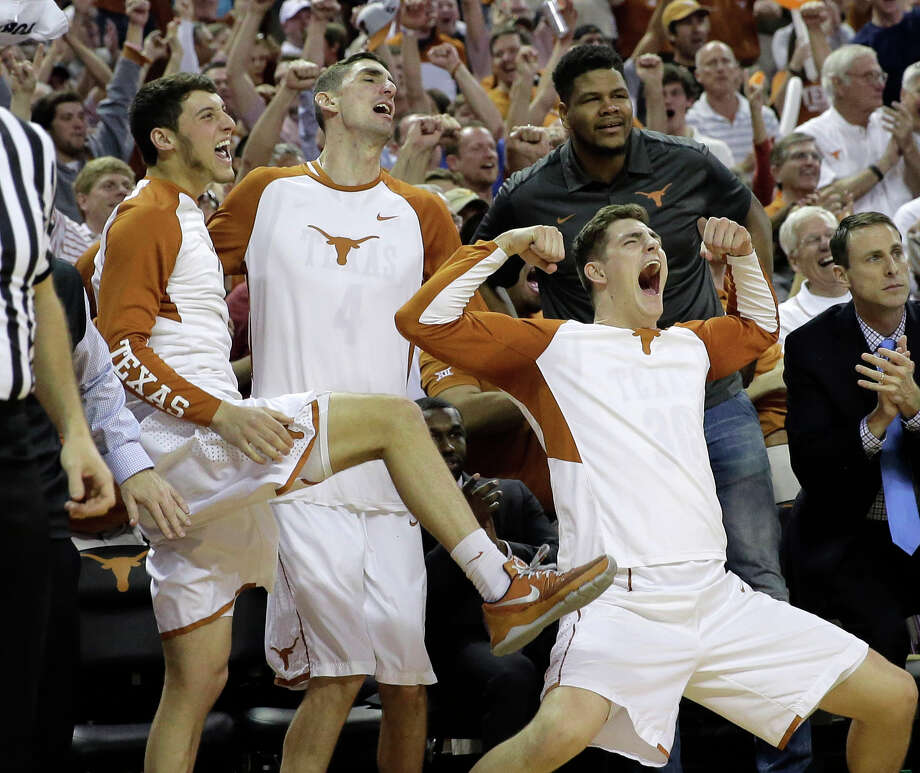 Texas' Ryan McClurg, right, a junior forward, and teammates celebrate from the bench during the second half of No. 25 Texas' win over third-ranked Oklahoma. Photo: Eric Gay, STF / AP