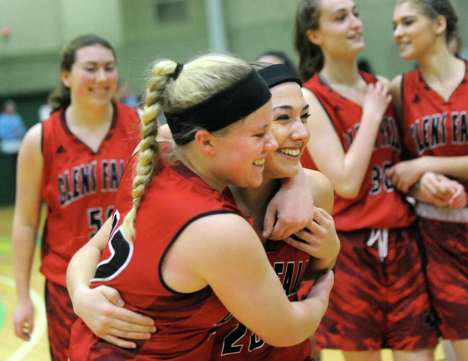 Glens Falls' Emilie Moses, second from left, and Caitlin Hogan, center, celebrate their 45-36 win over Hoosick Falls in the Class B basketball final on Saturday, Feb. 27, 2016, at Hudson Valley Community College in Troy, N.Y. (Cindy Schultz / Times Union) Photo: Cindy Schultz / Albany Times Union