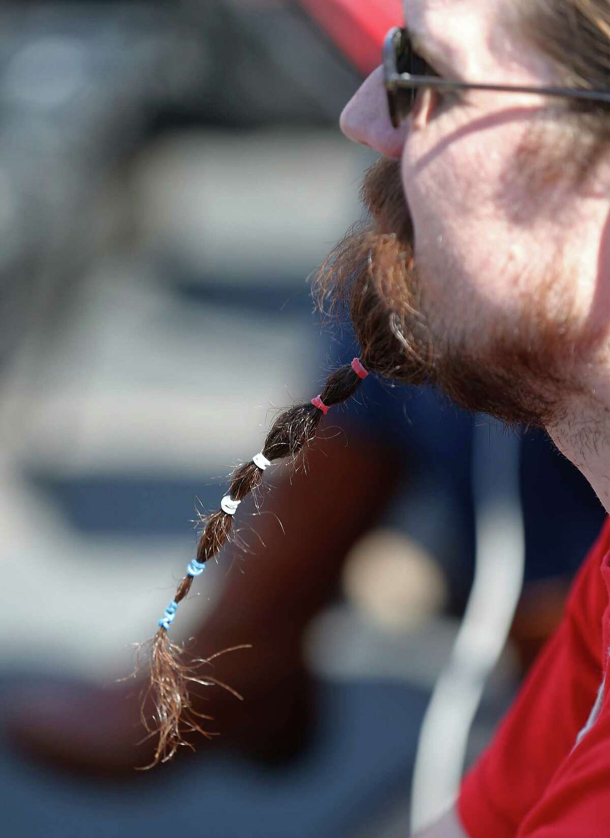 Campaign volunteer Tim Maxwell uses patriotic-colored rubber bands to tie his beard as Democratic presidential candidate and U.S. Senator Bernie Sanders rallies supporters at the Circuit of the Americas near Austin on Saturday, Feb. 27, 2016 as the campaign stumps for the upcoming Texas Primary. Thousands of supporters lined up to see Sanders and to hear his proposals if he were to be elected president. Sanders touched on topics of workers' wages, immigration, health insurance, bank reform and free public college and university tuition. Over 6,500 were reported to be at the rally as many were still filing in as Sanders spoke. The Texas Primary will take place on March 1. (Kin Man Hui/San Antonio Express-News)