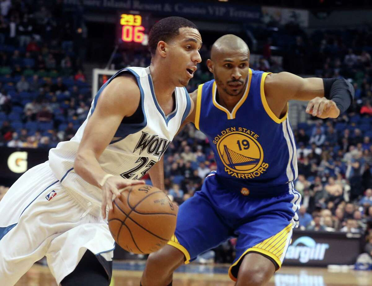 Minnesota Timberwolves?' Kevin Martin, left, drives around Golden State Warriors?' Leandro Barbosa of Brazil in the first quarter of an NBA basketball game, Wednesday, Feb. 11, 2015, in Minneapolis. (AP Photo/Jim Mone)
