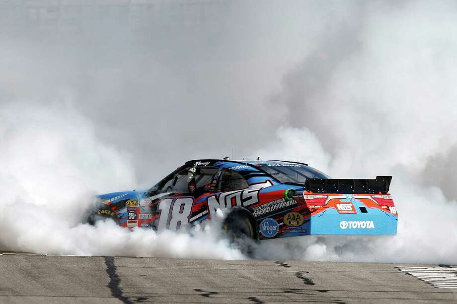 HAMPTON, GA - FEBRUARY 27:  Kyle Busch, driver of the #18 NOS Energy Drink Toyota, celebrates with a burnout after winning the NASCAR XFINITY Series Heads Up Georgia 250 at Atlanta Motor Speedway on February 27, 2016 in Hampton, Georgia.  (Photo by Brian Lawdermilk/Getty Images) ORG XMIT: 606799559 Photo: Brian Lawdermilk / 2016 Getty Images