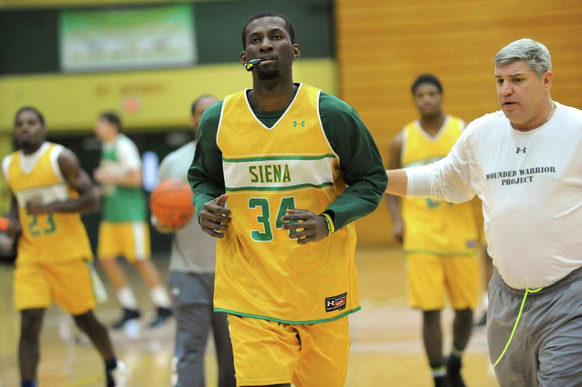 Siena's Imoh Silas, center, with coach Jimmy Patsos, right, during basketball practice on Tuesday, Nov. 26, 2013, at Siena College, N.Y. (Cindy Schultz / Times Union)