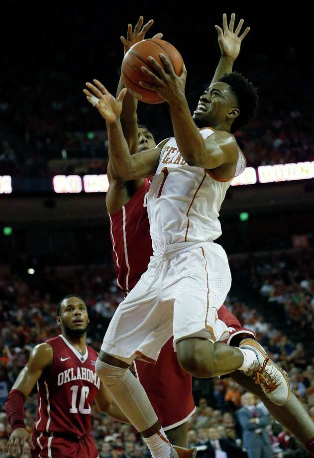 UT's Isaiah Taylor, right, takes it to the hole against OU's Dante Buford. Taylor, a junior guard, had a team-high  18 points despite being 5-for-15 from the field. Photo: Chris Covatta, Stringer / 2016 Getty Images