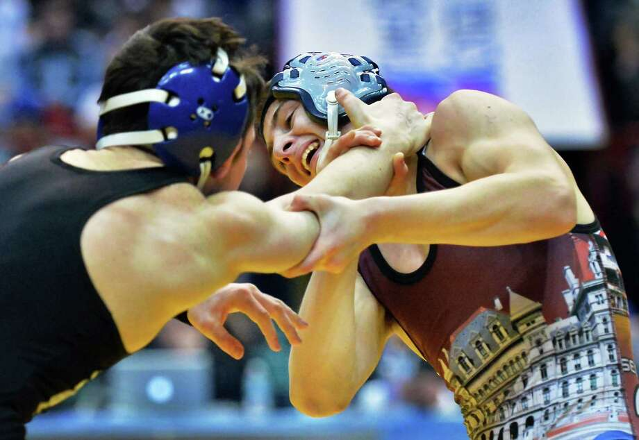 Columbia's John Devine, right, and North Babylon's Anthony Sparacio wrestle in 120lbs final during the state wrestling championships at the Times Union Center Saturday Feb, 27, 2016 in Albany, NY.  (John Carl D'Annibale / Times Union) Photo: John Carl D'Annibale / 10035523A