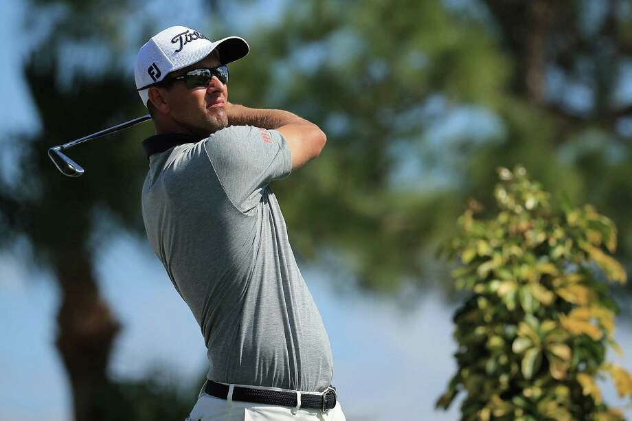 PALM BEACH GARDENS, FL - FEBRUARY 27:  Adam Scott of Australia hits his tee shot on the fourth hole during the third round of the Honda Classic at PGA National Resort & Spa - Champions Course on February 27, 2016 in Palm Beach Gardens, Florida.  (Photo by Mike Ehrmann/Getty Images) ORG XMIT: 592303683 Photo: Mike Ehrmann / 2016 Getty Images
