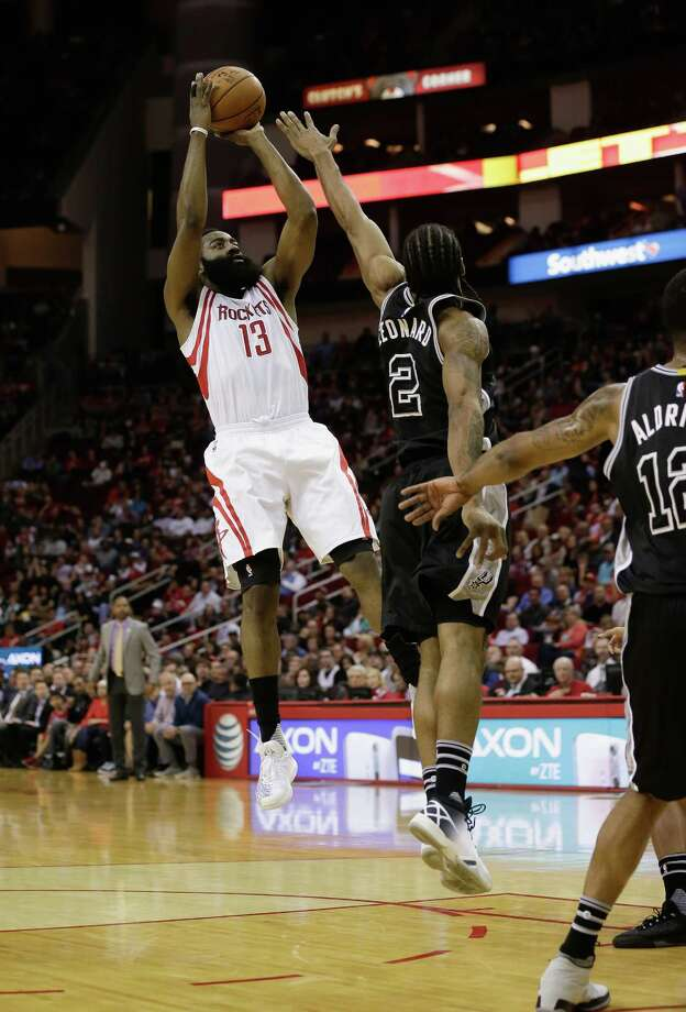 Houston Rockets guard James Harden (13) shoots over San Antonio Spurs forward Kawhi Leonard (2) during the first half of an NBA basketball game Saturday, Feb. 27, 2016, in Houston. (AP Photo/Bob Levey) Photo: Bob Levey, Associated Press / FR156786 AP