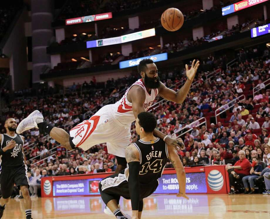 Houston Rockets guard James Harden (13) is called for an offensive foul as he collides with San Antonio Spurs guard Danny Green during the first half of an NBA basketball game Saturday, Feb. 27, 2016, in Houston. (AP Photo/Bob Levey) Photo: Bob Levey, Associated Press / FR156786 AP