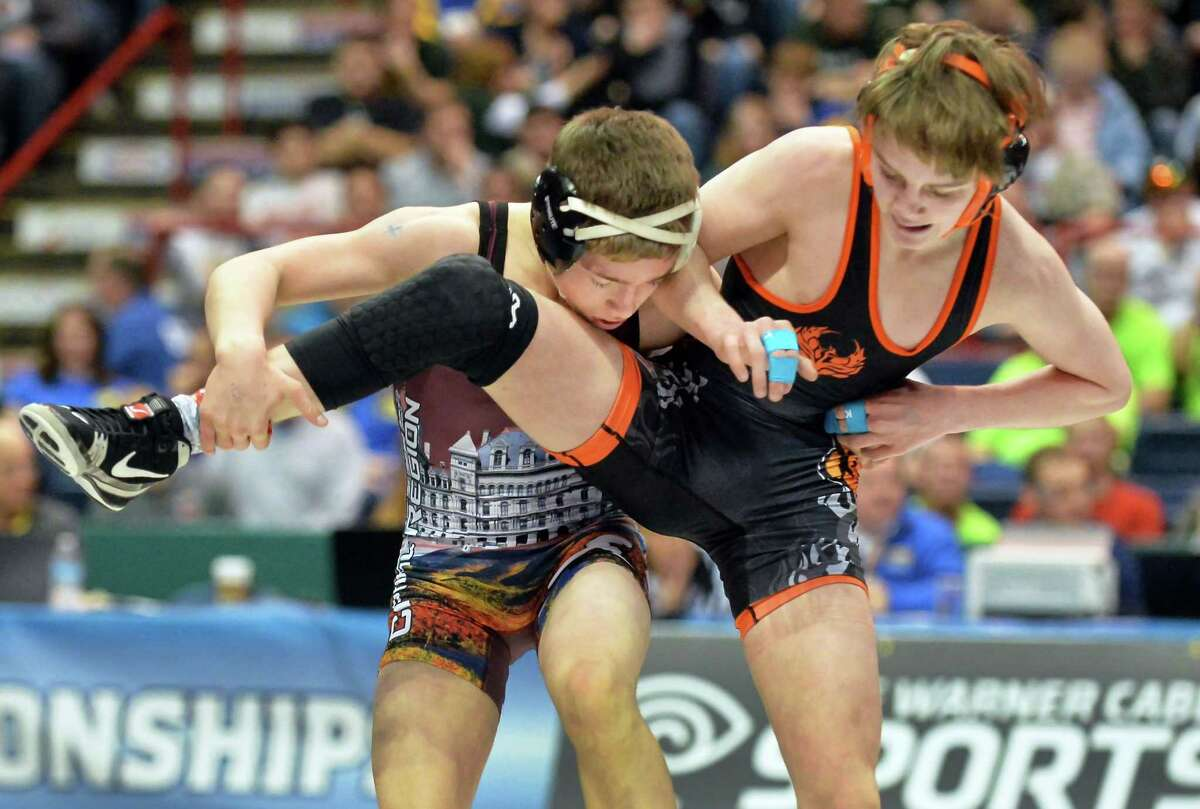 Schuylerville's Orion Anderson , left, on his way to defeating Phoenix's Cahal Donovan in the 106lbs. weight class during the state wrestling championships at the Times Union Center Saturday Feb, 27, 2016 in Albany, NY. (John Carl D'Annibale / Times Union)