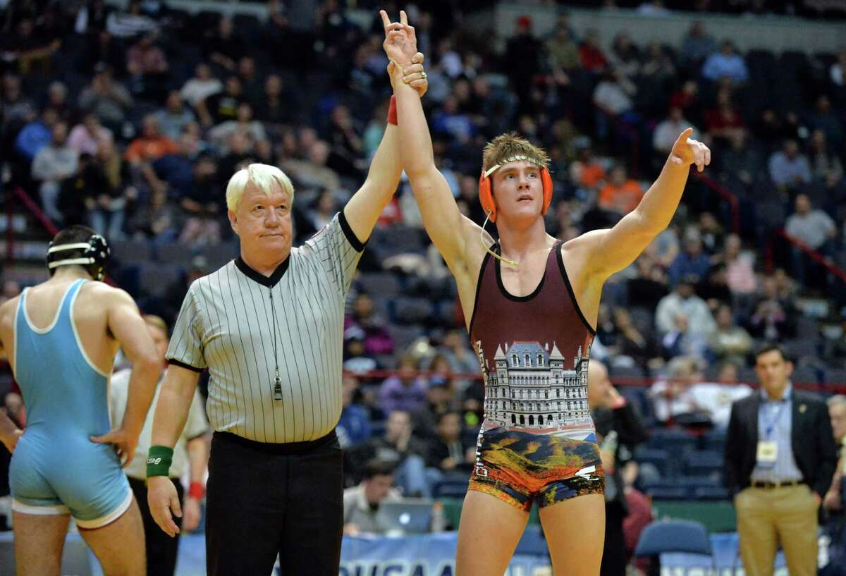 Shen's Kevin Parker, left has his hand raised in victory after defeating Lakeland Panas's Alexander Melikian, left, for the 182lbs. final during the state wrestling championships at the Times Union Center Saturday Feb, 27, 2016 in Albany, NY. (John Carl D'Annibale / Times Union)