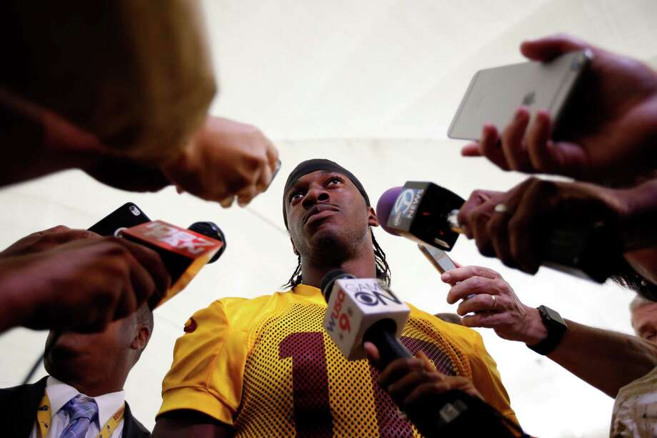 Washington Redskins quarterback Robert Griffin III speaks to reporters after NFL football practice, Tuesday, Aug. 18, 2015, in Ashburn, Va. (AP Photo/Alex Brandon) Photo: Alex Brandon, STF / Associated Press / AP