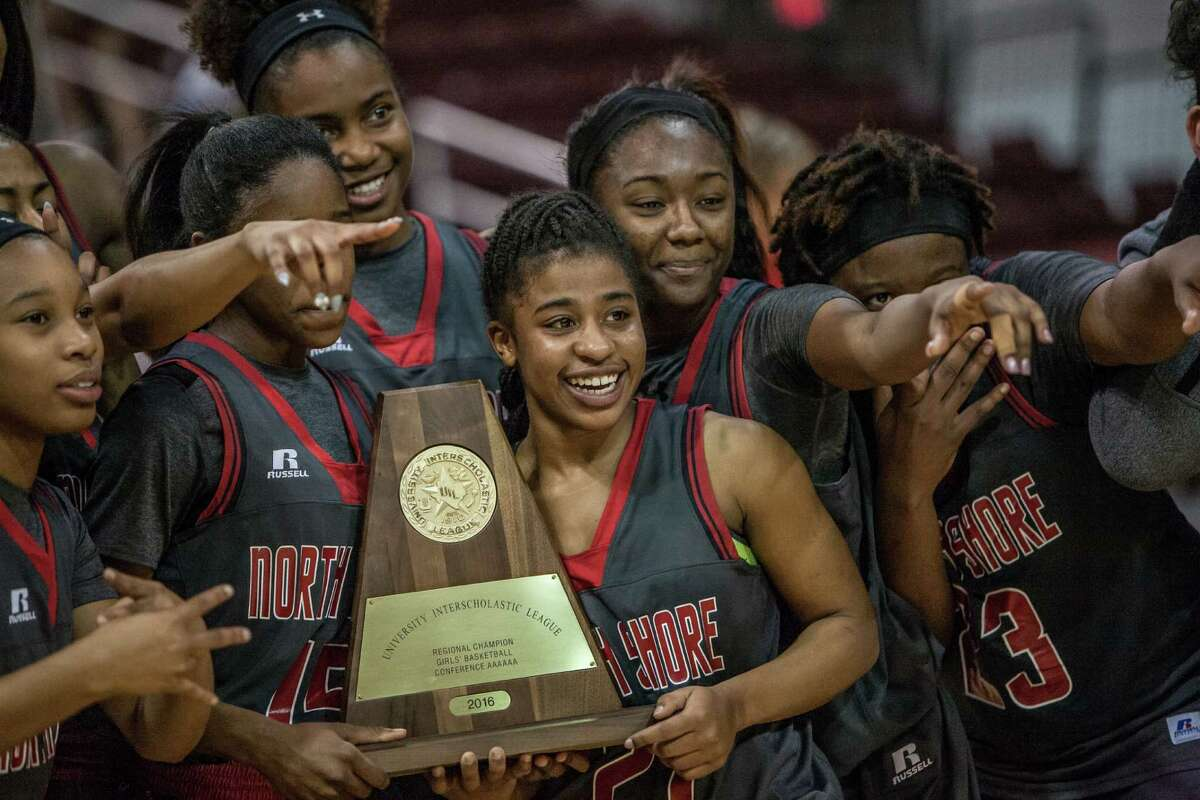 Madisyn Francis of North Shore celebrates with her teammates after winning the Region III final Saturday February 27, 2016. North Shore played Clear Springs in the girls basketball Region III finals at the Campbell Center.