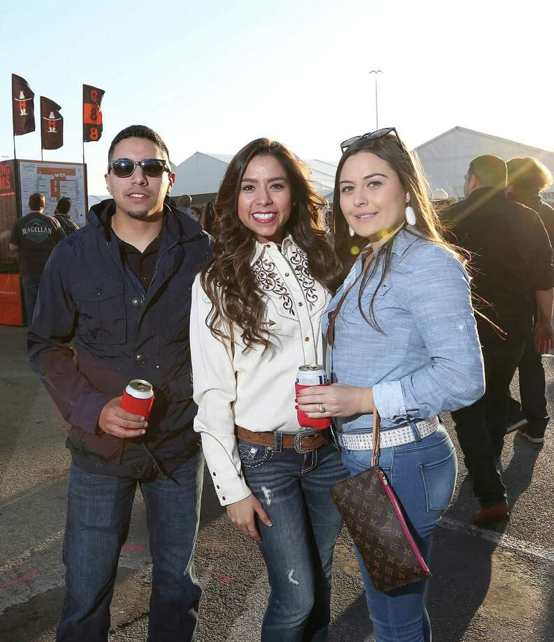 People pose for a photo at the Houston Livestock Show and Rodeo's World's Championship Barbecue Contest Saturday, Feb. 27, 2016, in Houston. Photo: Jon Shapley, Houston Chronicle / © 2015  Houston Chronicle