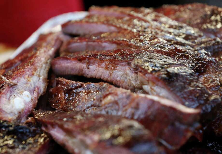 """Continue clicking to see photos of the rodeo barbecue contest.Pictured: A tray of pork ribs from """"The Original Pearl Cookers,"""" is seen at the Houston Livestock Show and Rodeo's World's Championship Barbecue Contest. Photo: Jon Shapley, Houston Chronicle / © 2015  Houston Chronicle"""