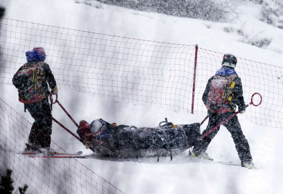 Lindsey Vonn is taken off the course after crashing during a World Cup super-G race at Soldeu-el-Tarter, Andorra, on Saturday. Despite breaking a bone in her left knee, Vonn has not ruled out racing today. Photo: Pier Marco Tacca, STR / AP