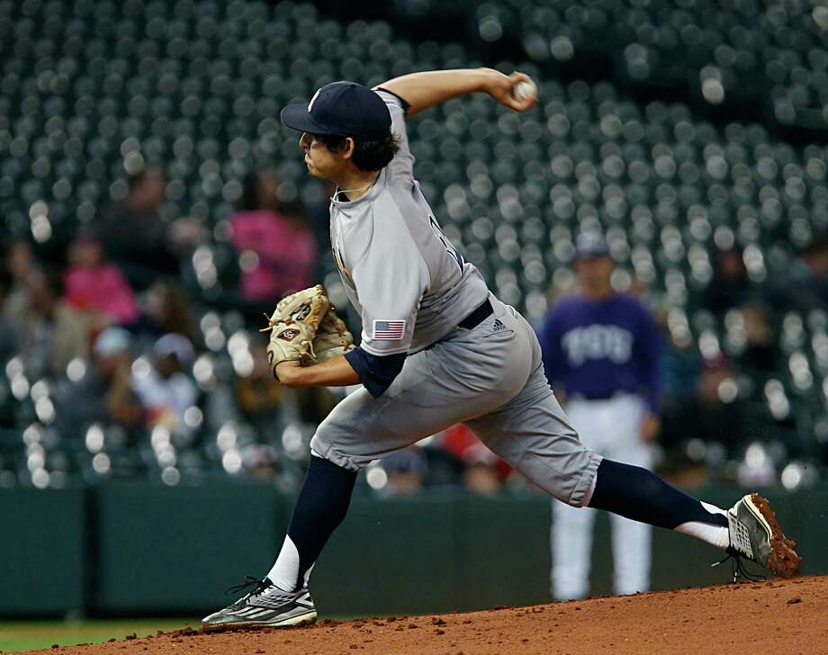 Rice's Ricardo Salinas throws a pitch during first inning of the 2016 Shriners Hospitals for Children College Classic baseball game against TCU at Minute Maid Park Saturday, Feb. 27, 2016, in Houston. Photo: James Nielsen, Houston Chronicle / © 2016  Houston Chronicle