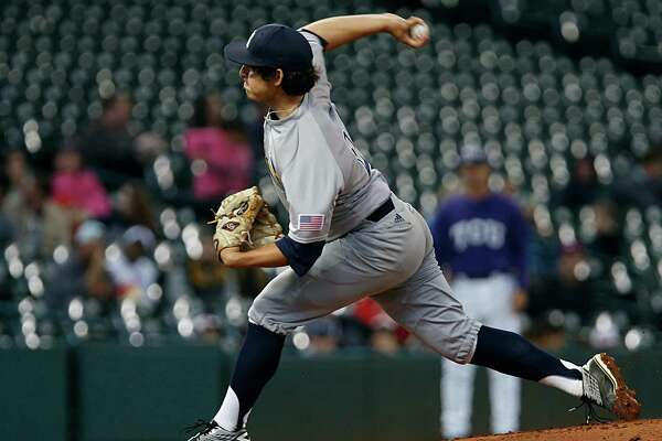 Rice's Ricardo Salinas throws a pitch during first inning of the 2016 Shriners Hospitals for Children College Classic baseball game against TCU at Minute Maid Park Saturday, Feb. 27, 2016, in Houston.