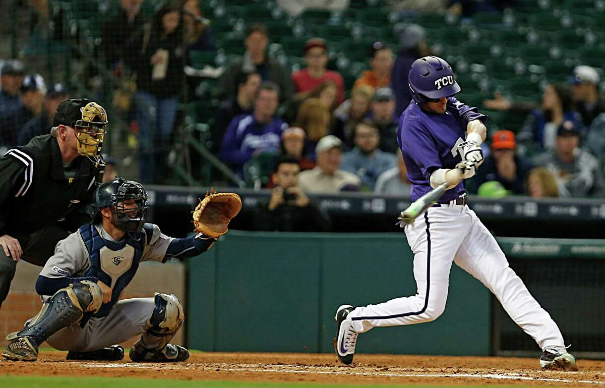TCU outfielder Dane Steinhagen, hits a 2-run double during second inning of the 2016 Shriners Hospitals for Children College Classic baseball game against Rice at Minute Maid Park Saturday, Feb. 27, 2016, in Houston.