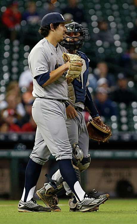 Rice pitcher Ricardo Salinas left, chats with catcher Hunter Kopycinski right, during second inning of the 2016 Shriners Hospitals for Children College Classic baseball game against TCU at Minute Maid Park Saturday, Feb. 27, 2016, in Houston. Photo: James Nielsen, Houston Chronicle / © 2016  Houston Chronicle