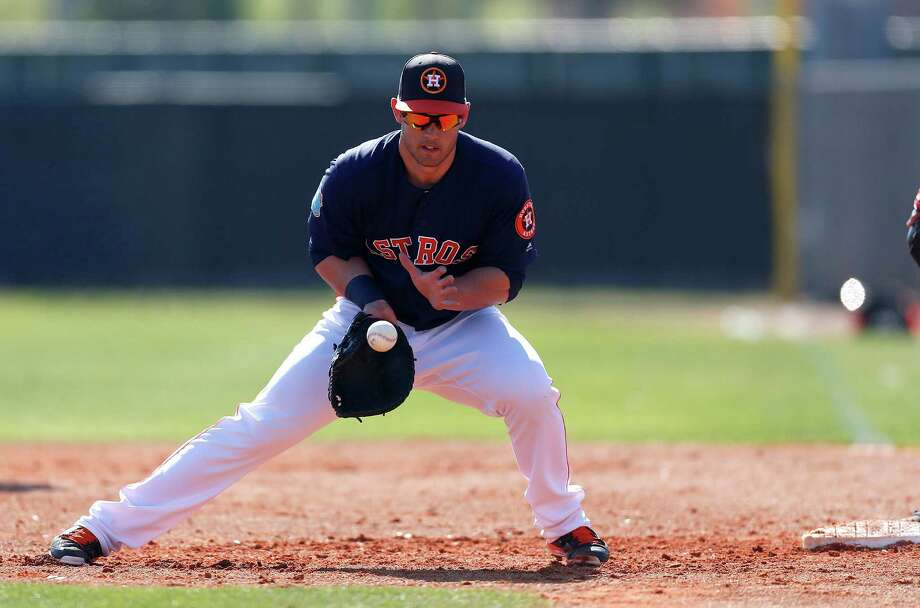 After being limited to the outfield and designated hitter in 2015, Preston Tucker takes part in defensive drills at first base for the first time in camp Saturday. Photo: Karen Warren, Staff / © 2015  Houston Chronicle