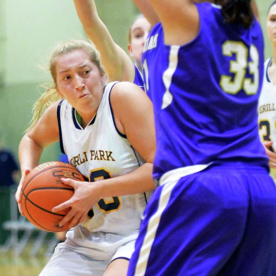Averill Park's #30 Samantha Larnajo, left, battles Amsterdam defenders during their Class A Girls' Basketball final Saturday Feb. 27, 2016 in Troy, NY.  (John Carl D'Annibale / Times Union) Photo: John Carl D'Annibale / 10035568A