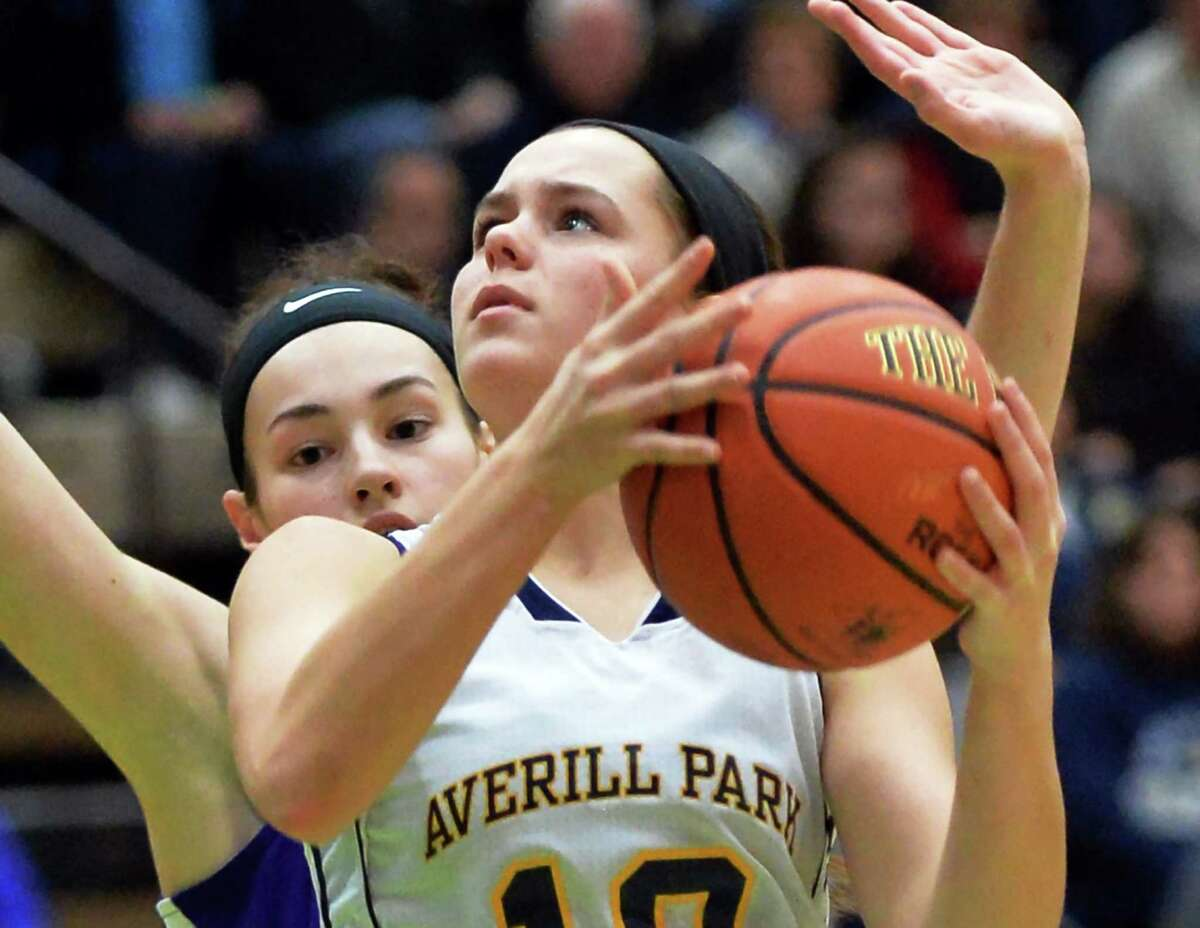 Averill Park's #10 Stephanie Janovic goes to the basket defended by Amsterdam's #11 Nina Fedullo, left, during their Class A Girls' Basketball final Saturday Feb. 27, 2016 in Troy, NY. (John Carl D'Annibale / Times Union)