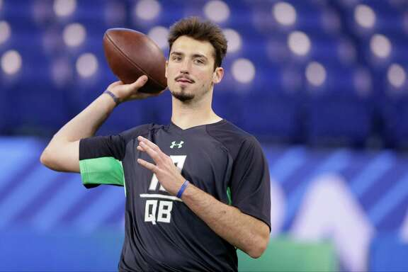 Memphis quarterback Paxton Lynch runs a drill at the NFL football scouting combine in Indianapolis, Saturday, Feb. 27, 2016. (AP Photo/Michael Conroy)