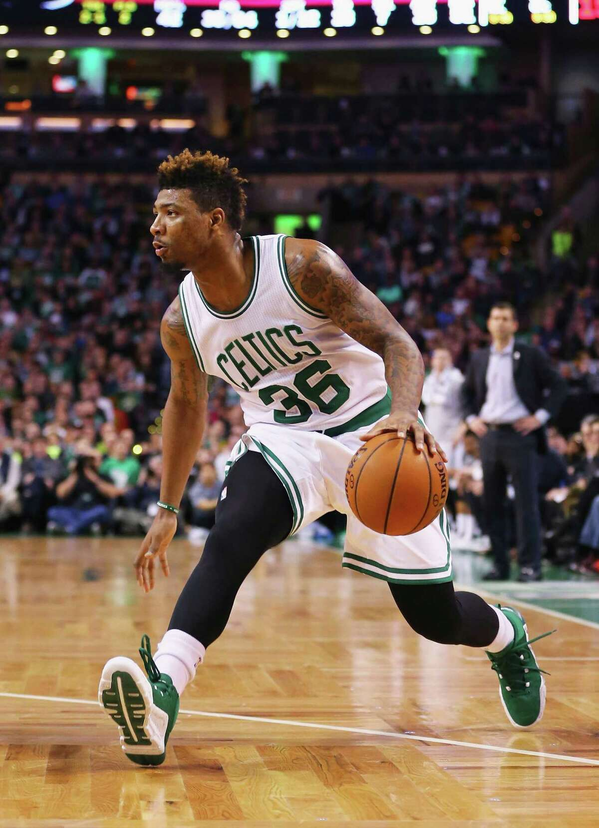 BOSTON, MA - FEBRUARY 27: Marcus Smart #36 of the Boston Celtics dribbles against the Miami Heat during the fourth quarter at TD Garden on February 27, 2016 in Boston, Massachusetts. The Celtics defeat the Heat 101-89. (Photo by Maddie Meyer/Getty Images) ORG XMIT: 575730973