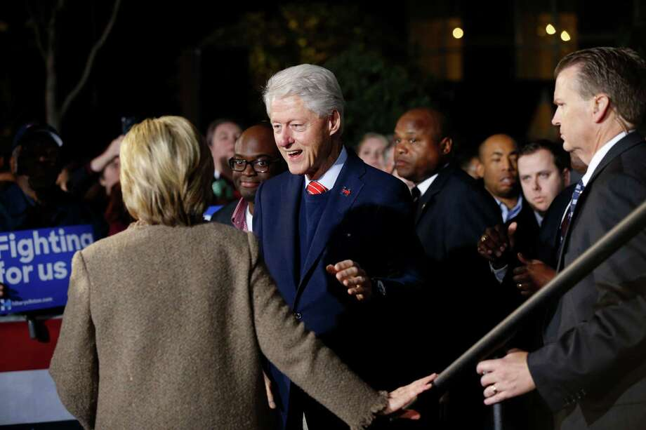 "Democratic presidential candidate Hillary Clinton and her husband, former President Bill Clinton, arrive to speak at a ""Get Out The Vote Rally"" in Columbia, S.C., Friday, Feb. 26, 2016. (AP Photo/Gerald Herbert) Photo: Gerald Herbert, STF / AP"