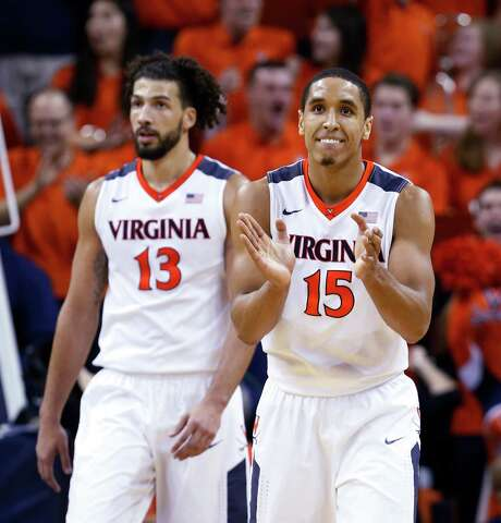 Anthony Gill, left, and Malcolm Brogdon and combined for 41 of third-ranked Virginia's 79 points in Saturday's victory over No. 7 North Carolina. Photo: Steve Helber, STF / AP