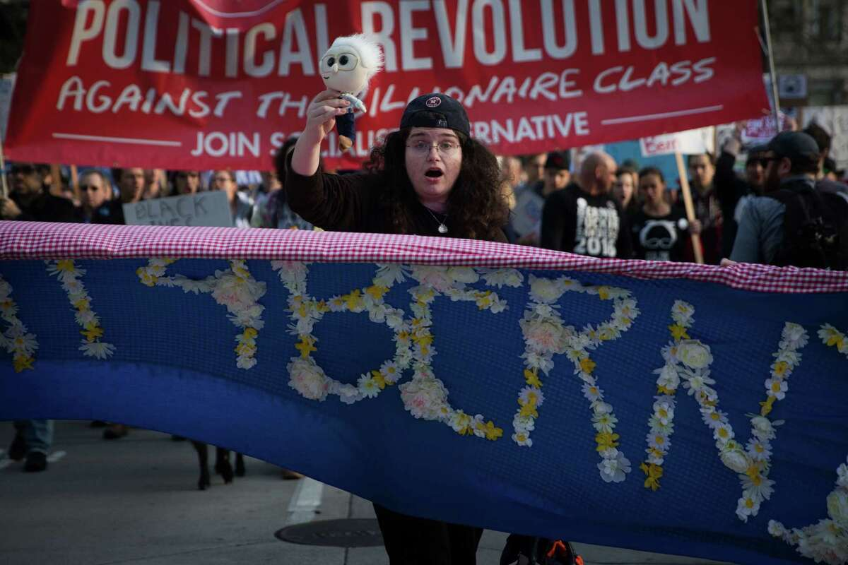 Supporters of Democratic presidential candidate Bernie Sanders march on Fourth Avenue toward Westlake Center in downtown Seattle on Saturday, Feb. 26, 2016.