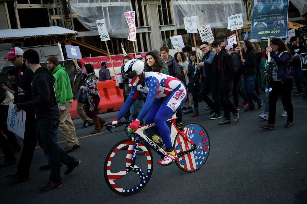 A cyclist in all-American gear rides through the march.