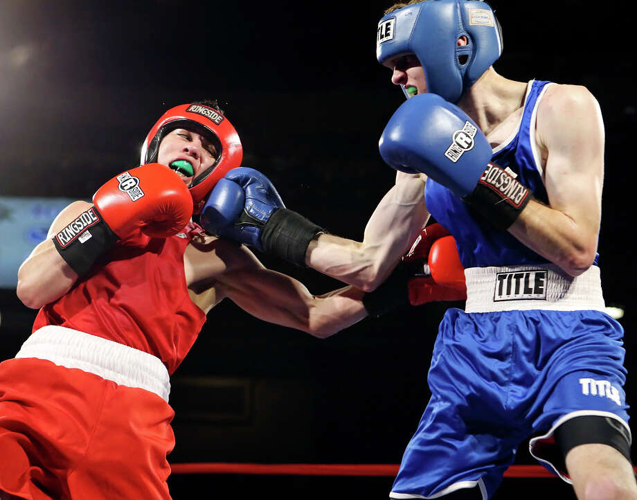 Guillermo Gutierrez (left) and Daniel Reed exchange punches during their open flyweight championship bout