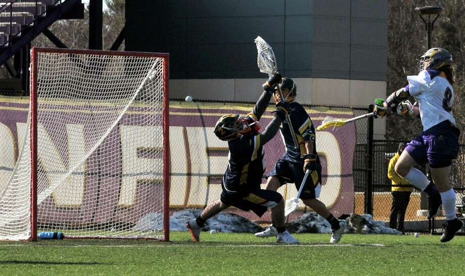 Derrick Eccles scores against Drexel in the third quarter, adding to their final score of 20 points during men's lacrosse first official game of the season on Saturday, Feb. 27, 2016, at University at Albany in Albany, N.Y. (Brittany Gregory / Special to the Times Union) Photo: Brittany Gregory