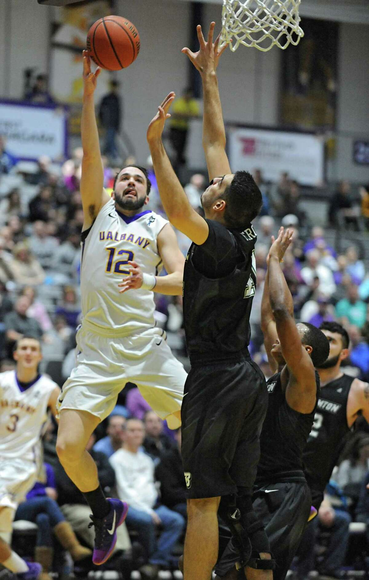 UAlbany's Peter Hooley is fouled as he sinks this two pointer during an America East Conference basketball game against Binghamton at the SEFCU Arena on Monday, Jan. 18, 2016 in Albany, N.Y. (Lori Van Buren / Times Union)