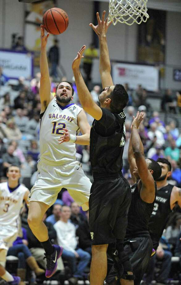 UAlbany's Peter Hooley is fouled as he sinks this two pointer during an America East Conference basketball game against Binghamton at the SEFCU Arena on Monday, Jan. 18, 2016 in Albany, N.Y. (Lori Van Buren / Times Union) Photo: Lori Van Buren / 10034993A